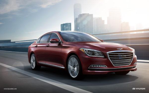 Red Hyundai Genesis luxury sedan driving down street