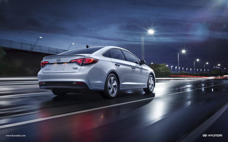 2017 Hyundai Sonata Plug-In Hybrid driving down highway at night