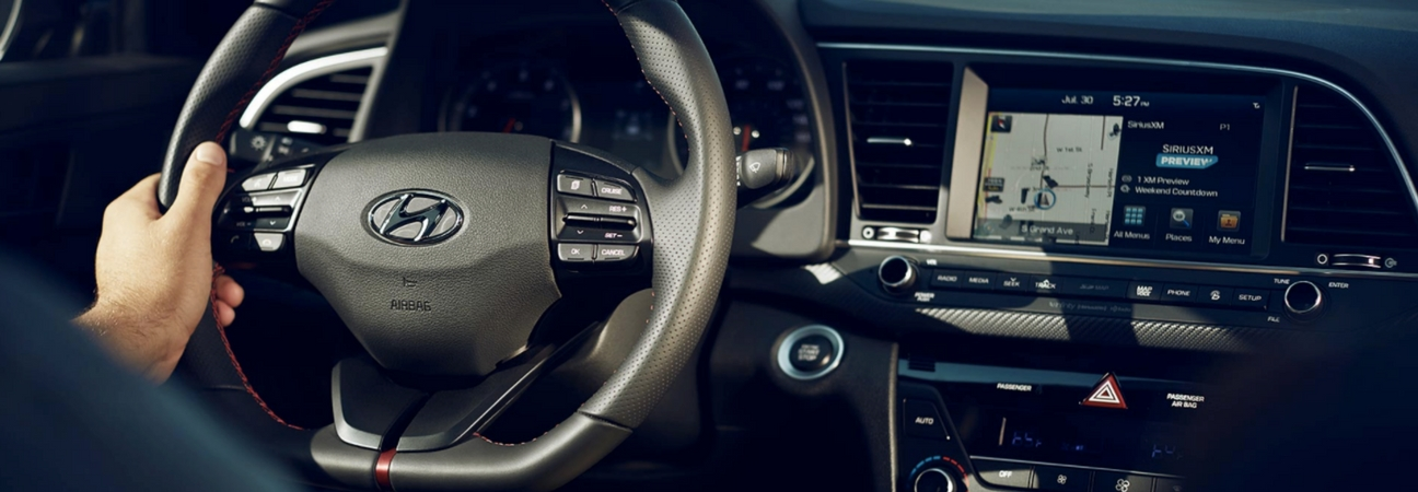 The steering wheel and dashboard of a 2018 Hyundai Elantra.