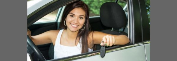 A woman sitting in a car holding keys in a blog post about used Hyundai cars.