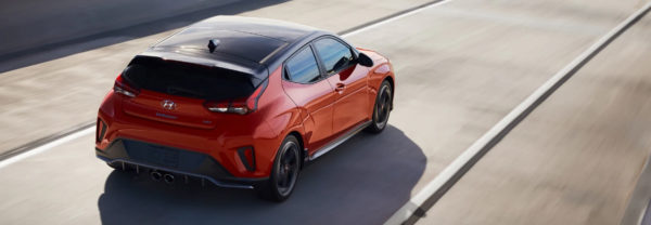 The 2019 Hyundai Veloster driving down the road
